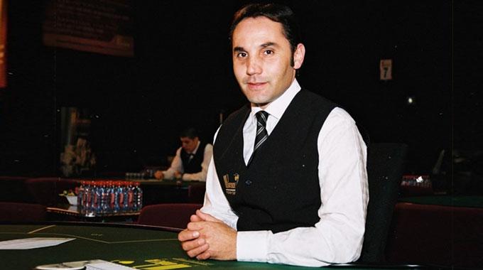 Poker Croupier in Casino